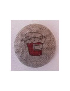 Bouton Pot de confiture rouge sur nature