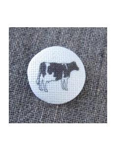 Bouton vache sur écru